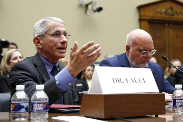 Dr. Anthony Fauci, left, director of the National Institute of Allergy and Infectious Diseases, testifies before a House Oversight Committee hearing on preparedness for and response to the coronavirus outbreak on Capitol Hill in Washington, Wednesday, March 11, 2020. Sitting alongside Fauci is Dr. Robert Redfield, director of the Centers for Disease Control and Prevention. (AP Photo/Patrick Semansky)